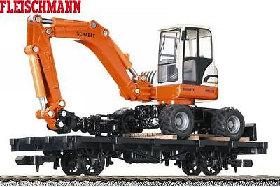 Fleischmann-Magic-Train-0e-243601-Flachwagen-mit-Bagger.jpg